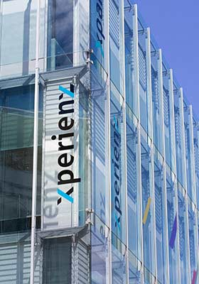 Building corner showing the Xperienz logo