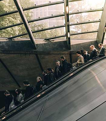 People going down on an escalator